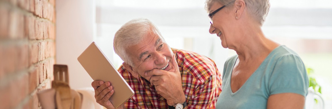 Older couple at home discussed self-managed superannuation.