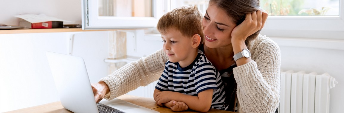 Mother with her child using a computer.